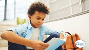 Image of a child reading a book form the Pizza Hut BOOK IT Summer Reading Program for Kids is Back article from That Homeschool Family written by Elizabeth Dukart