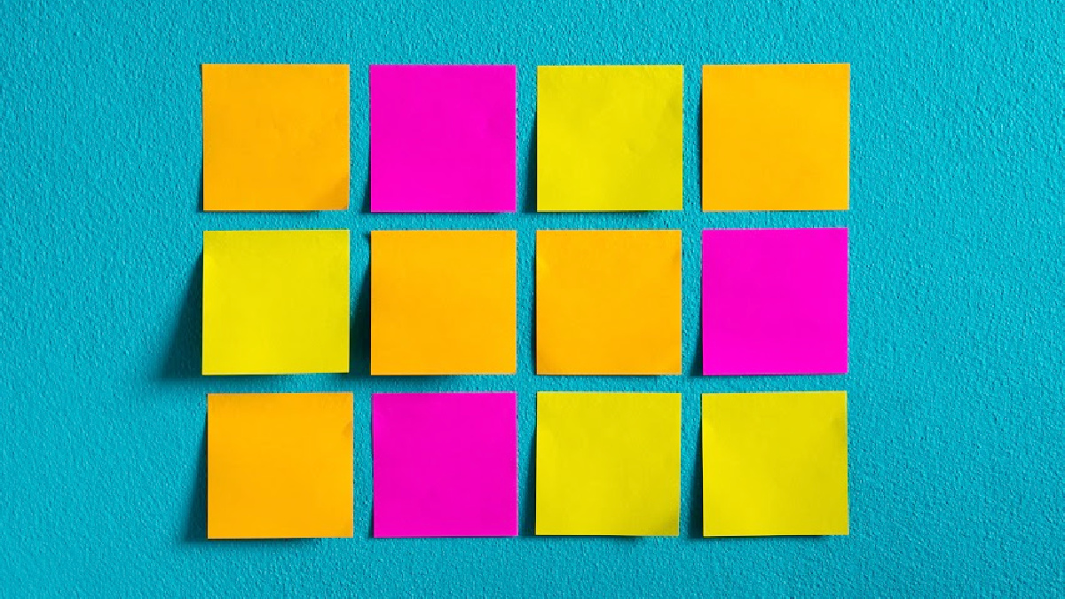 12 neon sticky notes on a blue wall for the 9 Creative Ways to Use Sticky Notes in your Homeschool article from That Homeschool Family written by Elizabeth Dukart