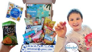 Homeschool Geography with Universal Yums image with various snacks and young boy holding Cadillac gummy candies from That Homeschool Family article written by Elizabeth Dukart