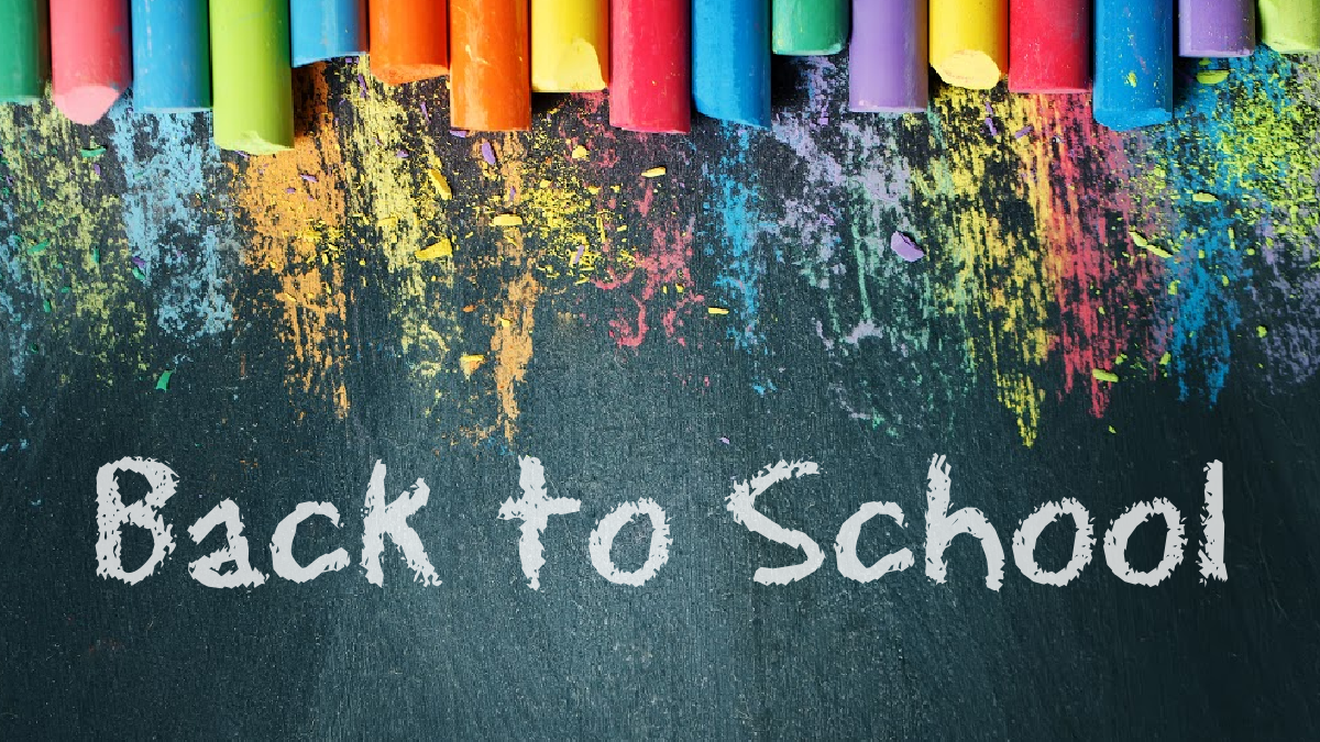 """Image of a chalkboard with rainbow colors of chalk on top with text """"back to school"""" in white in the center for the article 5 Back to School Traditions for Homeschoolers from That Homeschool Family written by Elizabeth Dukart"""
