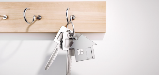 image of a new set of home keys hanging on the wall for the article 7 stress free ways to prepare kids for a move from That Homeschool Family written by Elizabeth Dukart