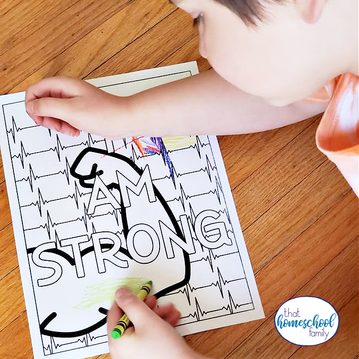 """image of a young child coloring the """"I am strong"""" positive affirmation coloring sheet"""